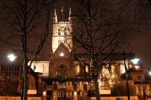 The floodlit north side of Southwark Cathedral on Christmas Eve.