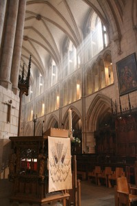 Sun streaming into Southwark Cathedral over the Pascal Candle