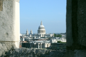 St Paul's Cathedral through the parapet of Southwark Cathedral tower.