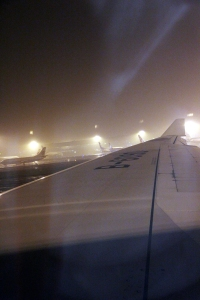 Mist rising from the taxiway following heavy rain at Beijing.
