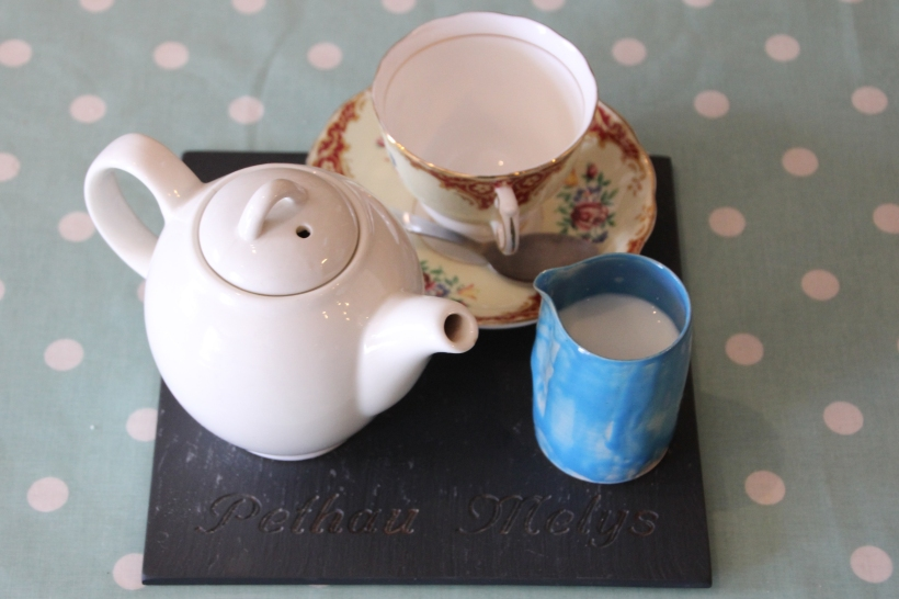 Tea served in a vintage cup and saucer. Milk jug made by Tom.