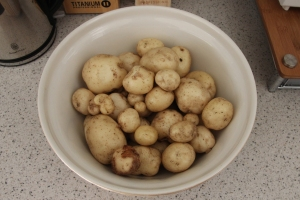 Potatoes cleaned, ready for scraping and dicing.