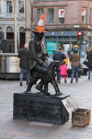 Living statue of the Duke of Wellington with traffic cone.
