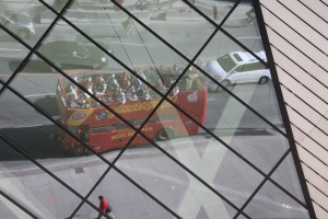 Sightseeing Bus reflected in the Crystal.