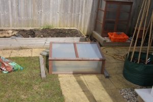 Cold frame removed with broken left side.