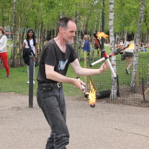Juggler with flaming clubs