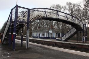 Footbridge and building on northbound platform.