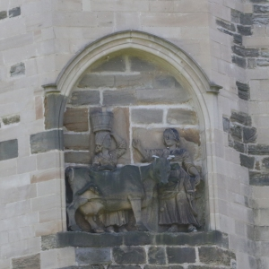 Carving of Milkmaids and Cow.