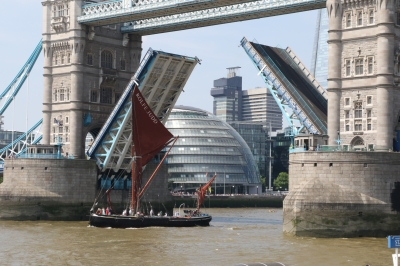 Barge Rolfe Judd passing through Tower Bridge