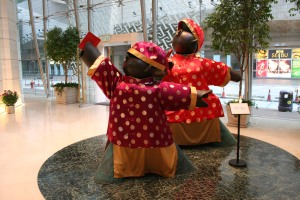 """""""Red Guard - Going Forward! Making Money!"""" in the street lobby of the Langham Place"""