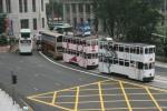 Hong Kong Trams 1 (Alain Mikli) and 46 [EQ:IQ Shop] following buses